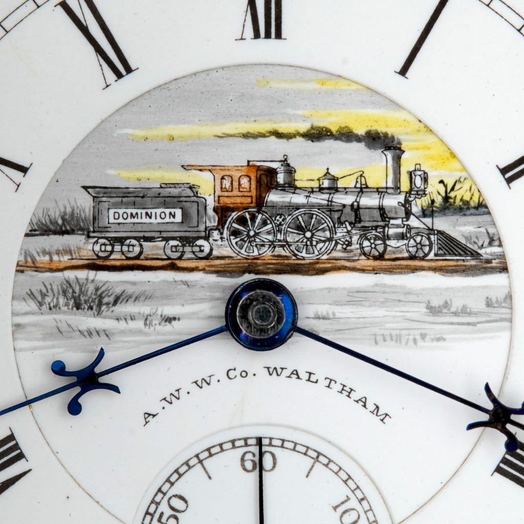 """Closeup of Hand-Colored """"Dominion"""" Locomotive Dial, Winter Scene, Fitted on a Waltham 18-Size Crescent St. Movement."""