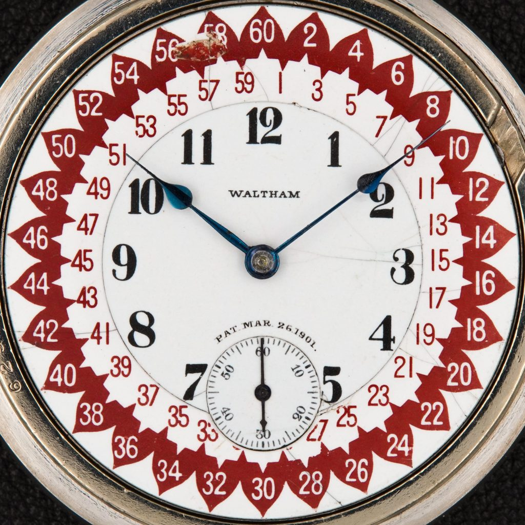 """Ezra C. Fitch's Red """"Annular Acorn"""" Dial with Staggered Marginal Minutes,, c.1901."""
