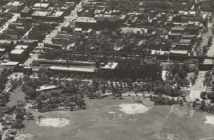Aerial view featuring the Babson Bros. warehouse (left) next to St. Anthony's Hospital